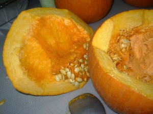 Prepping a raw pumpkin to cook