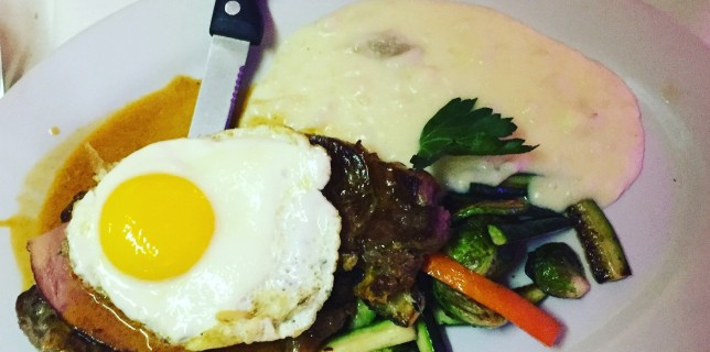 Steak topped with ham & fried egg at Sangria restaurant & tapas