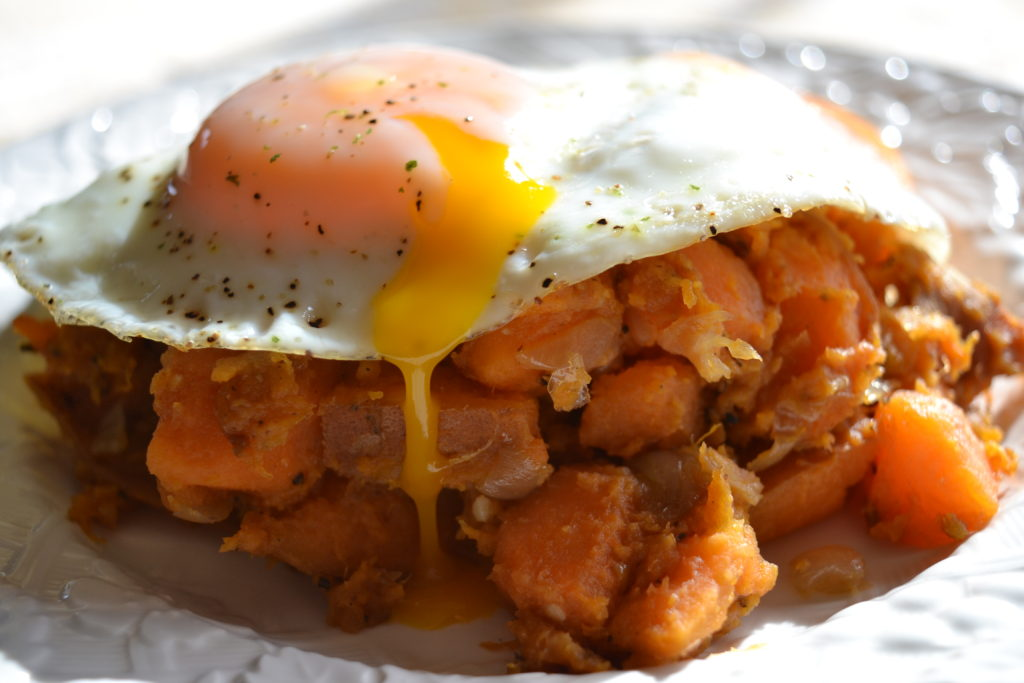 Whole 30 sweet potato hash with a sunny-side-up egg.