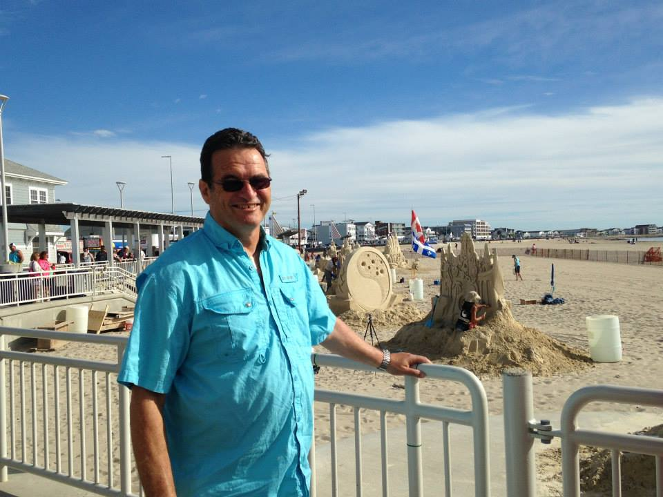 My dad checking out the Hampton Beach Sand Sculpture Competition last summer.