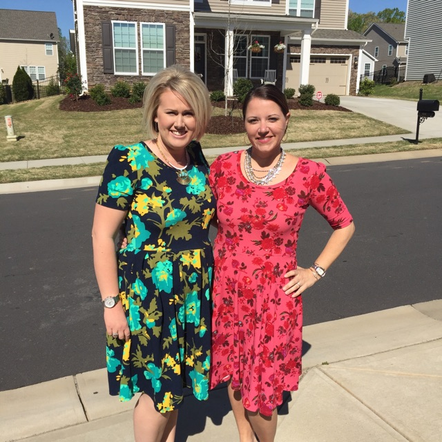 Missy (on the right) with a party hostess in their Nicole Dresses.